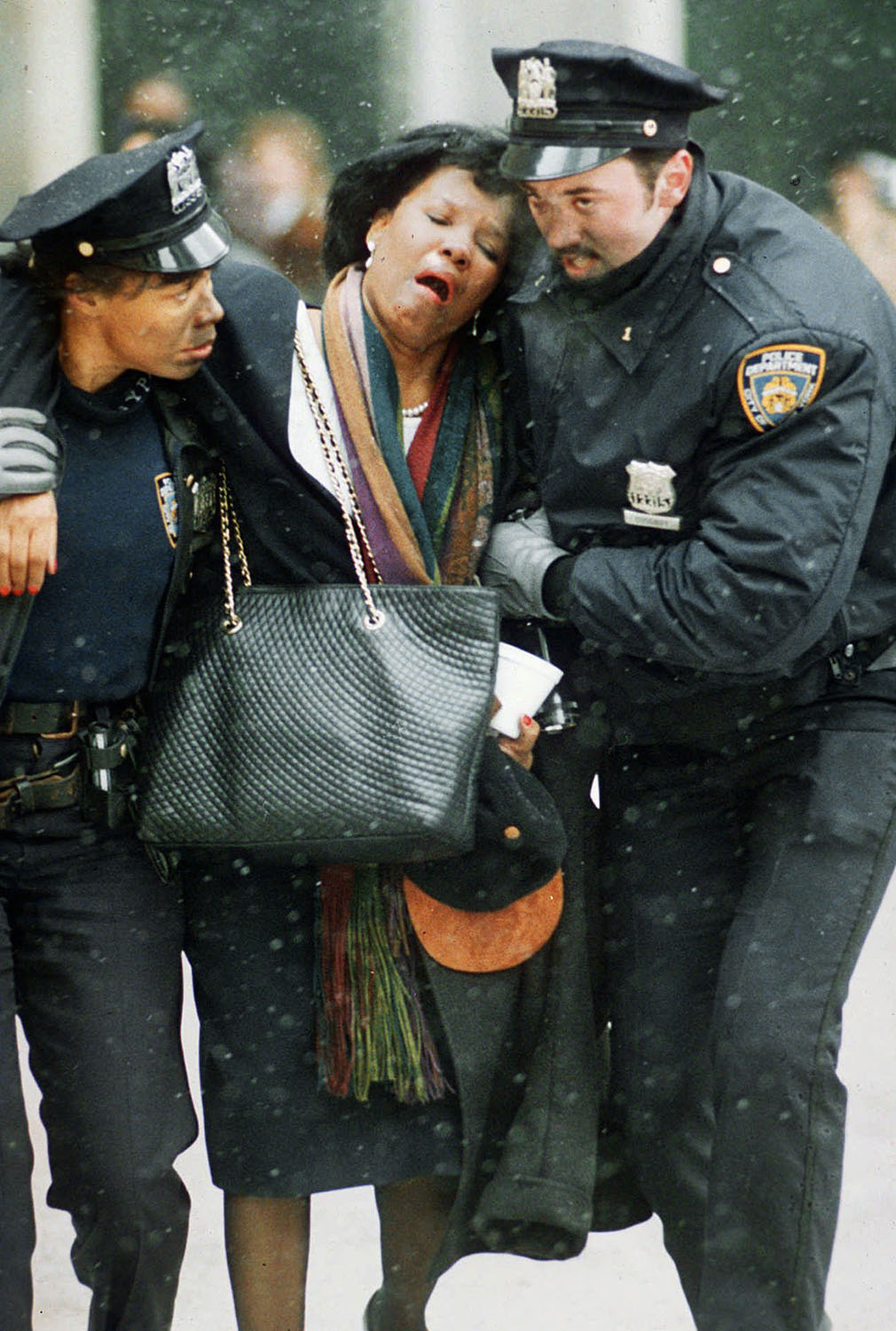 <div class='meta'><div class='origin-logo' data-origin='AP'></div><span class='caption-text' data-credit='AP Photo/Joe Tabacca'>Two New York City police officers help an injured women away from the scene of the World Trade Center explosion.</span></div>