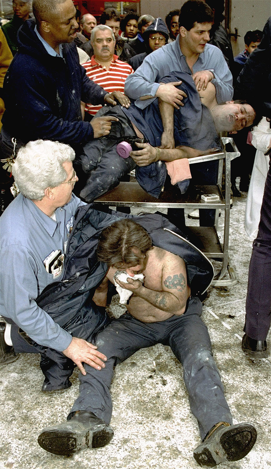 <div class='meta'><div class='origin-logo' data-origin='AP'></div><span class='caption-text' data-credit='AP Photo/Marty Lederhandler'>Victims of a fire at the World Trade Center in New York are treated at the scene after an explosion rocked the complex.</span></div>