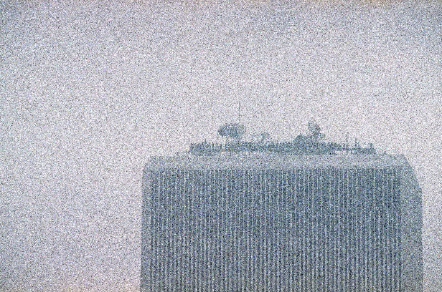 <div class='meta'><div class='origin-logo' data-origin='AP'></div><span class='caption-text' data-credit='AP Photo/Val Mazzucca'>People line the observation deck of the World Trade Center in New York, Feb. 26, 1993.</span></div>