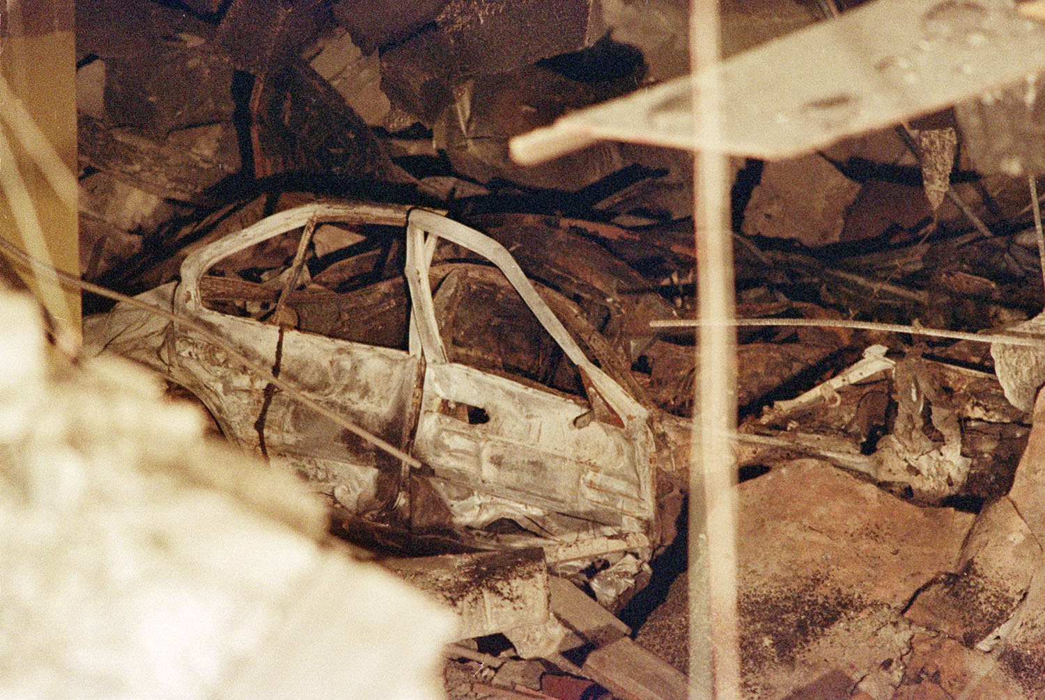 <div class='meta'><div class='origin-logo' data-origin='AP'></div><span class='caption-text' data-credit='AP Photo/Ron Frehm'>A destroyed car lies underneath a section of rubble in the sub-basement of New York's World Trade Center, seen Feb. 28, 1993.</span></div>