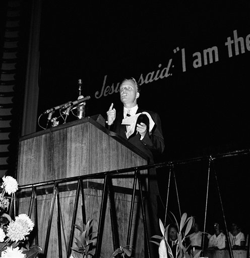 "<div class=""meta image-caption""><div class=""origin-logo origin-image ap""><span>AP</span></div><span class=""caption-text"">Evangelist Billy Graham holds up Bible and gestures as he addresses opening session of month-long crusade in Philadelphia  August 20, 1961. (AP)</span></div>"