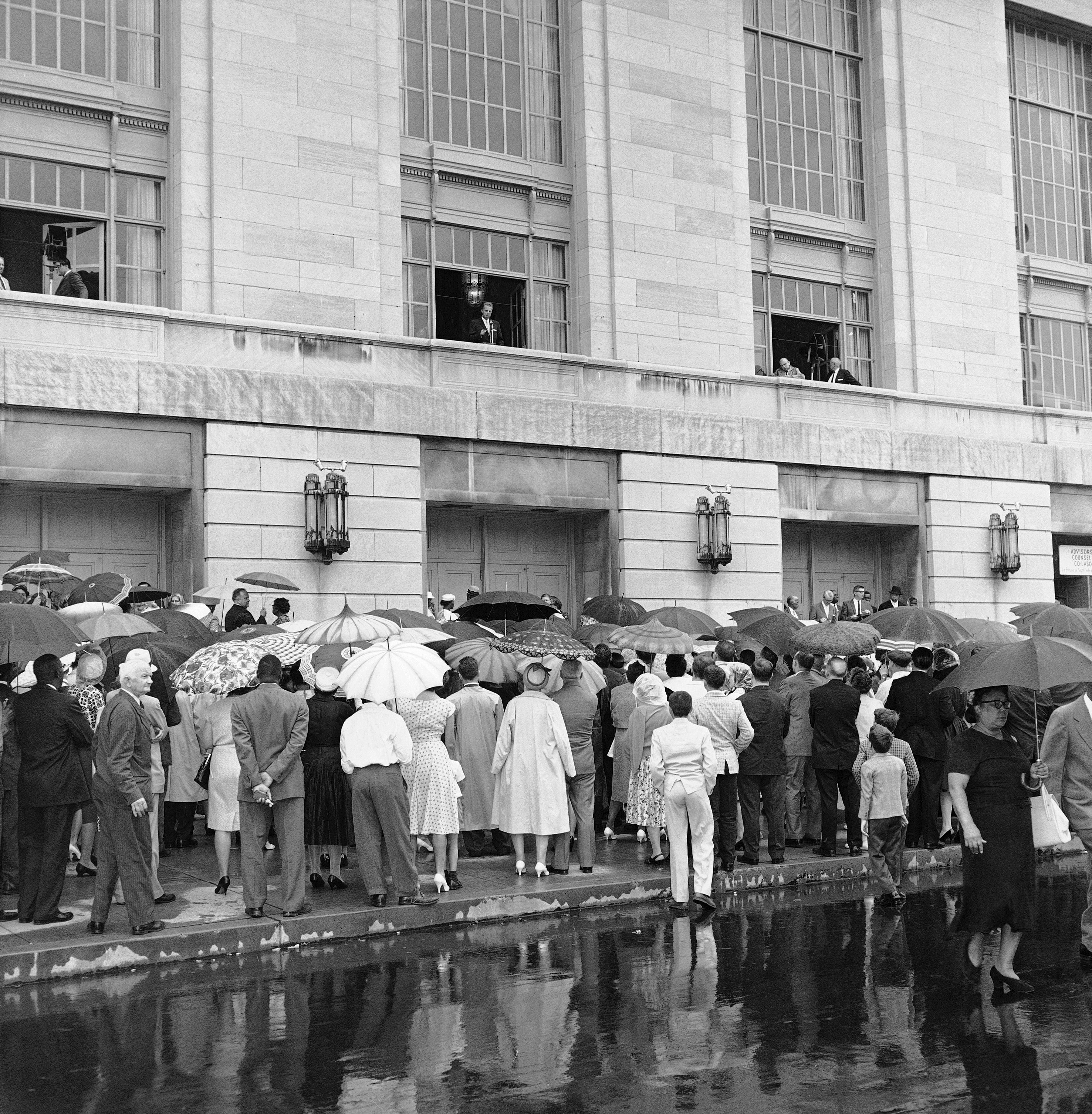 "<div class=""meta image-caption""><div class=""origin-logo origin-image ap""><span>AP</span></div><span class=""caption-text"">Part of an overflow crowd estimated at 2,000 stands in rain outside Philadelphia's Convention Hall on August 20, 1961 to hear brief talk by Evangelist Billy Graham. (AP)</span></div>"