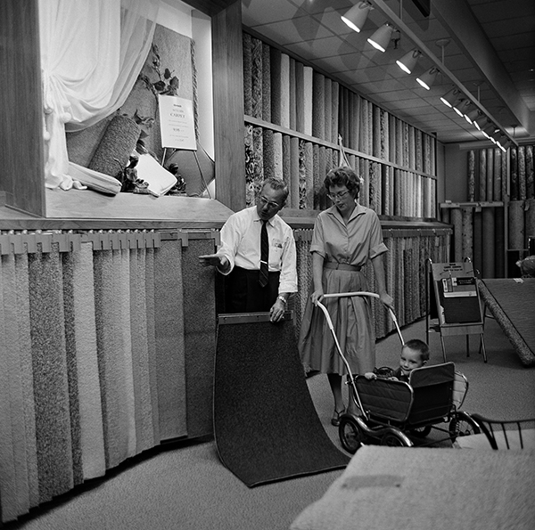 "<div class=""meta image-caption""><div class=""origin-logo origin-image ap""><span>AP</span></div><span class=""caption-text"">N. Subrin, left, manager of the floor cover department at the Golf-Mill Sears Roebuck department store in Niles, Ill., shows Mrs. G. Moeri a carpet sample, Aug. 23, 1961. (AP Photo)</span></div>"