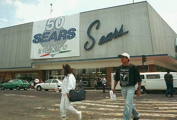 "<div class=""meta image-caption""><div class=""origin-logo origin-image ap""><span>AP</span></div><span class=""caption-text"">People walk by the Sears store in Mexico City, Wednesday, April 2, 1997. (AP Photo/Marco Ugarte)</span></div>"