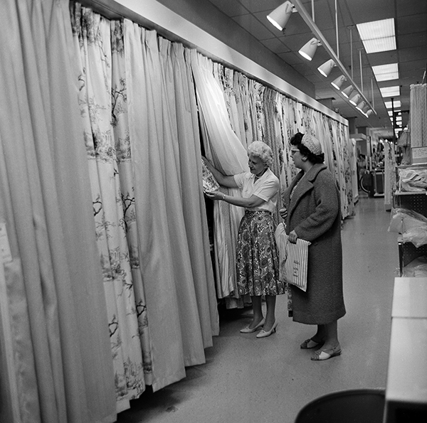 "<div class=""meta image-caption""><div class=""origin-logo origin-image ap""><span>AP</span></div><span class=""caption-text"">Shopper, Mrs. Arlene Hardt, right, is shown drapery samples by clerk Lucille Jagusch at the Golf-Mill Sears Roebuck department store in Niles, Ill., Aug. 23, 1961. (AP Photo)</span></div>"