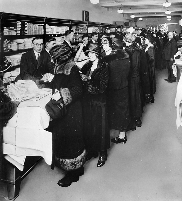 "<div class=""meta image-caption""><div class=""origin-logo origin-image ap""><span>AP</span></div><span class=""caption-text"">** FILE ** In this file photo from an unknown source, women crowd the counters of one of the first Sears retail stores in 1925. (AP Photo/File)</span></div>"