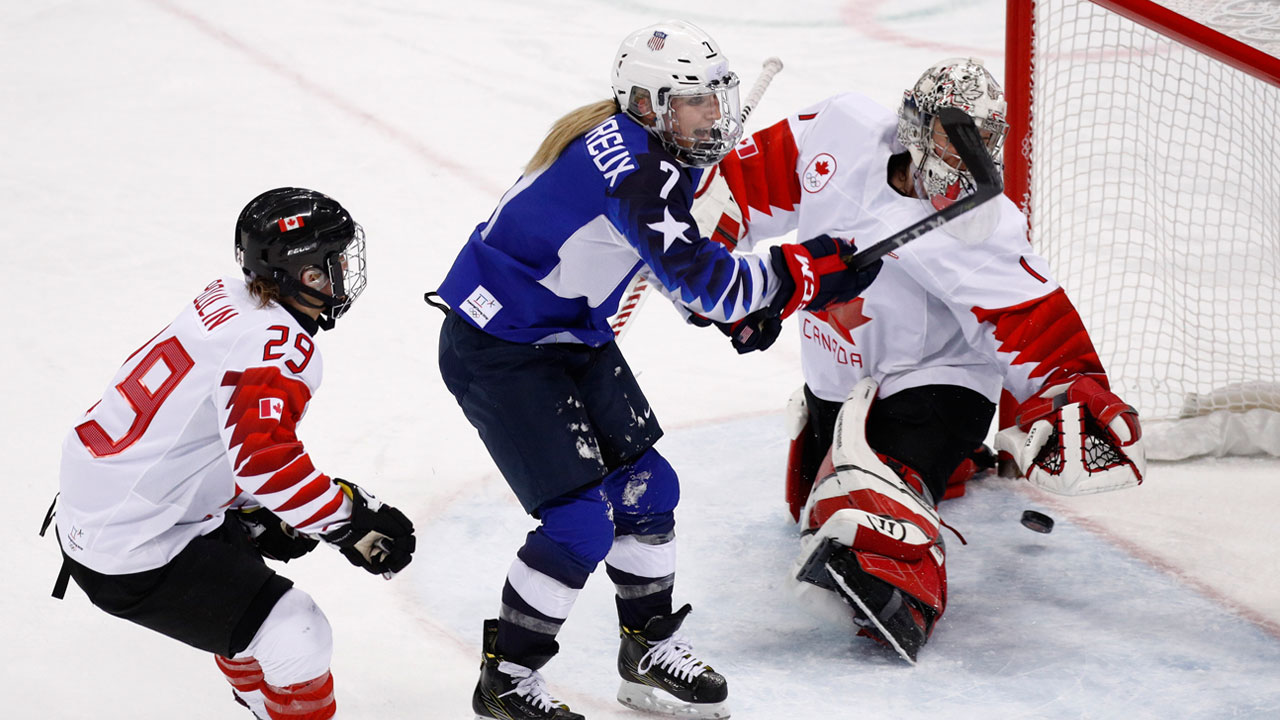 Monique Lamoureux-Morando, of the United States, shoots the puck for as goal during the women's gold medal hockey game at the 2018 Winter Olympics in Gangneung, South Korea.