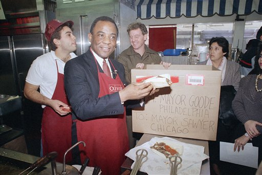 <div class='meta'><div class='origin-logo' data-origin='none'></div><span class='caption-text' data-credit='AP'>Philadelphia Mayor W. Wilson Goode, left, smiles as he lifts a cheesesteak, Jan. 5, 1989 at Philadelphia's Reading Terminal Market.</span></div>