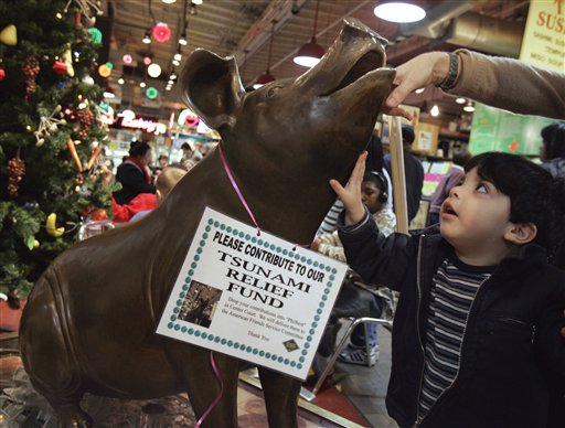 <div class='meta'><div class='origin-logo' data-origin='none'></div><span class='caption-text' data-credit=''>Sergio Jimenez-Piera watches his mother puts money in Philbert, a bronze pig statue, as she makes a donation to the Tsunami Relief Fund at Reading Terminal Market on Dec. 31, 2004.</span></div>