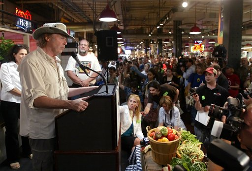<div class='meta'><div class='origin-logo' data-origin='none'></div><span class='caption-text' data-credit=''>Neil Young pauses while speaking at the Reading Terminal Market on July 6, 2006, during a news conference to announce Farm Aid's return.  (AP Photo/ Joseph Kaczmarek)</span></div>