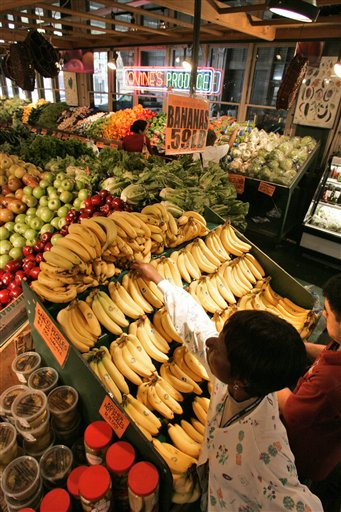 <div class='meta'><div class='origin-logo' data-origin='none'></div><span class='caption-text' data-credit='AP'>A customer reaches for bananas inside Philadelphia's Reading Terminal Market on Tuesday, July 17, 2007. (AP Photo/George Widman)</span></div>