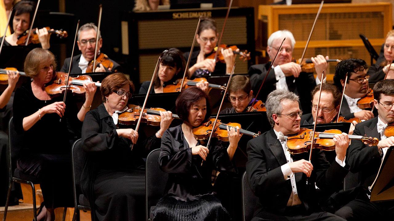 Musicians from the Los Angeles Philharmonic perform with Venezuela's conductor Gustavo Dudamel at Teresa Carreno in Caracas, Venezuela, Wednesday Feb. 15, 2012.