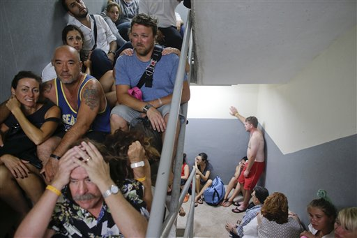 """<div class=""""meta image-caption""""><div class=""""origin-logo origin-image """"><span></span></div><span class=""""caption-text"""">Tourists sit on the concrete stairs in the service area of a resort after the designated area for shelter was destroyed by winds in Los Cabos, Mexico, Monday, Sept. 15, 2014. (AP)</span></div>"""