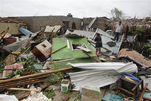 """<div class=""""meta image-caption""""><div class=""""origin-logo origin-image """"><span></span></div><span class=""""caption-text"""">A family salvages goods from their house that was destroyed by Hurricane Odile in Los Cabos, Mexico, Monday, Sept. 15, 2014. (AP)</span></div>"""