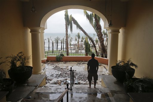 """<div class=""""meta image-caption""""><div class=""""origin-logo origin-image """"><span></span></div><span class=""""caption-text"""">A tourists looks to the ocean from inside a debris-filled area at the Hilton hotel after the resort sustained severe damage from Hurricane Odile in Los Cabos, Mexico. (AP)</span></div>"""
