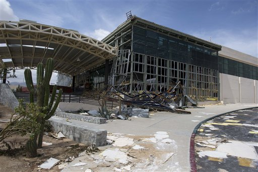 """<div class=""""meta image-caption""""><div class=""""origin-logo origin-image """"><span></span></div><span class=""""caption-text"""">The main entrance to the airport sits heavily damaged after hurricane Odile roared past San Jose de los Cabos, Mexico, Wednesday, Sept. 17, 2014. (AP)</span></div>"""
