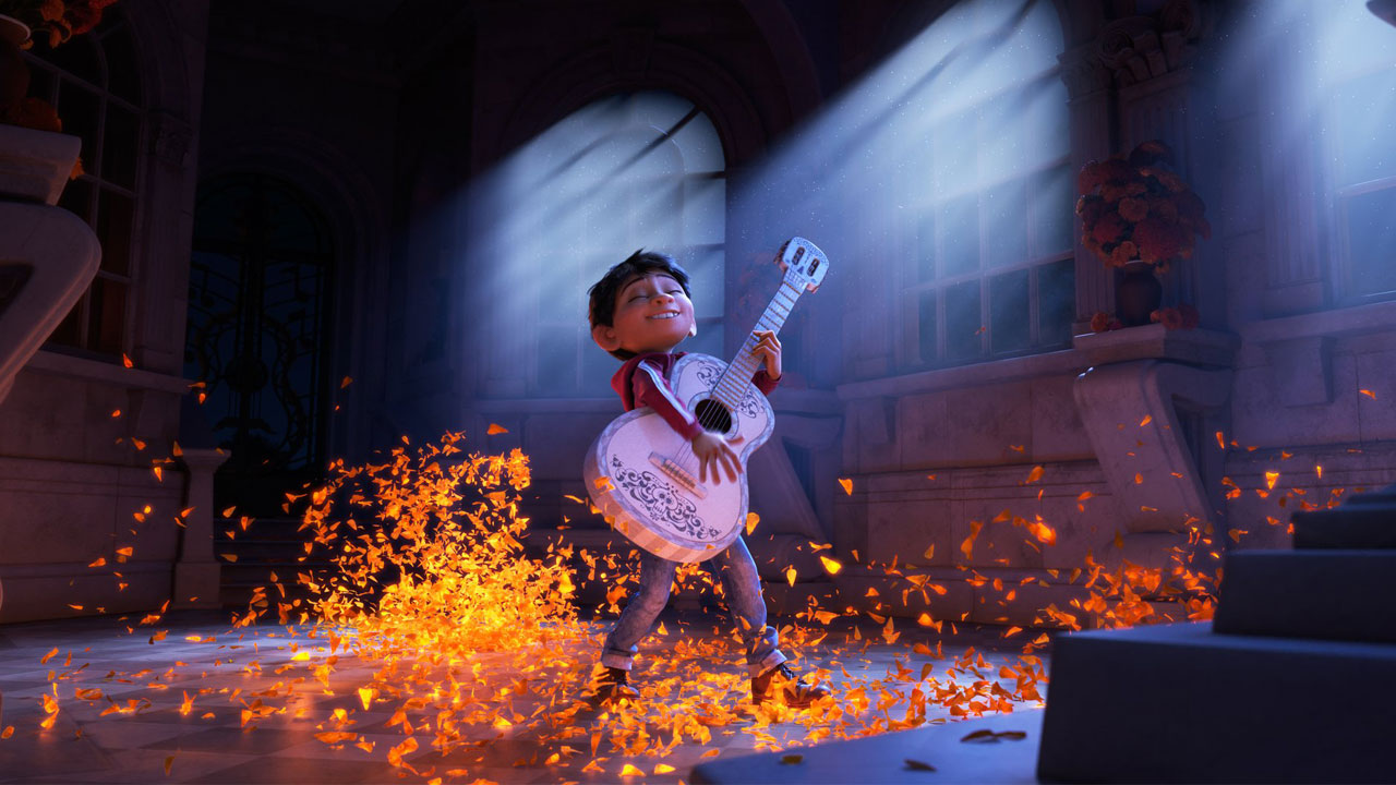 "Miguel from Pixar's ""Coco"" is shown playing a guitar in an image from the animated movie."
