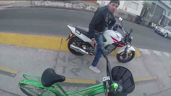 """<div class=""""meta image-caption""""><div class=""""origin-logo origin-image """"><span></span></div><span class=""""caption-text"""">Hennessy gets off his bike, offering it to the robber and explaining that he doesn't understand what the robber is asking for. (Photo/YouTube, Mike Graziano)</span></div>"""