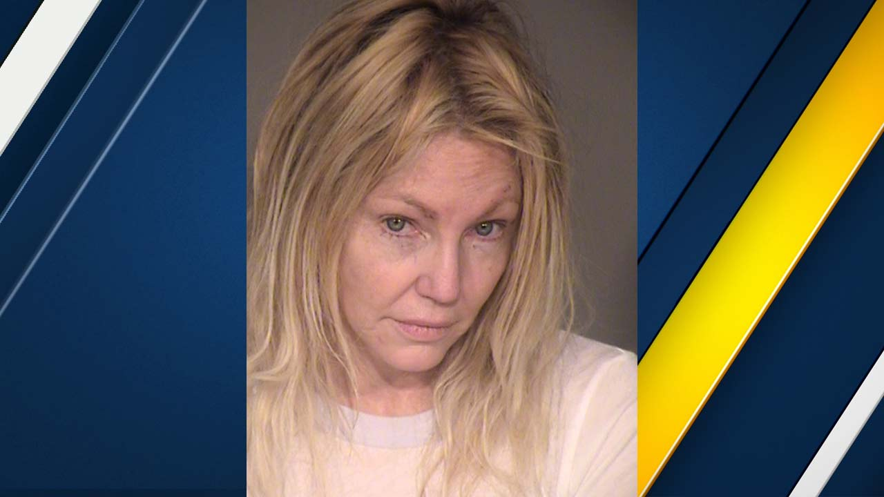 Heather Locklear appears in a booking photo released by the law enforcement.
