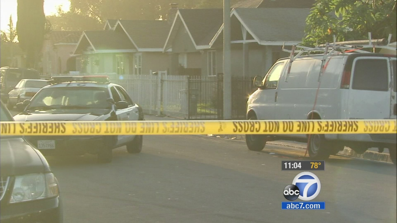 Authorities investigate a fatal stabbing in the Florence-Firestone area on Thursday, Sept. 18, 2014.