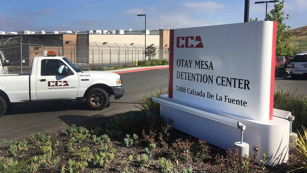 In this June 9, 2017, file photo, a vehicle drives into the Otay Mesa detention center in San Diego.