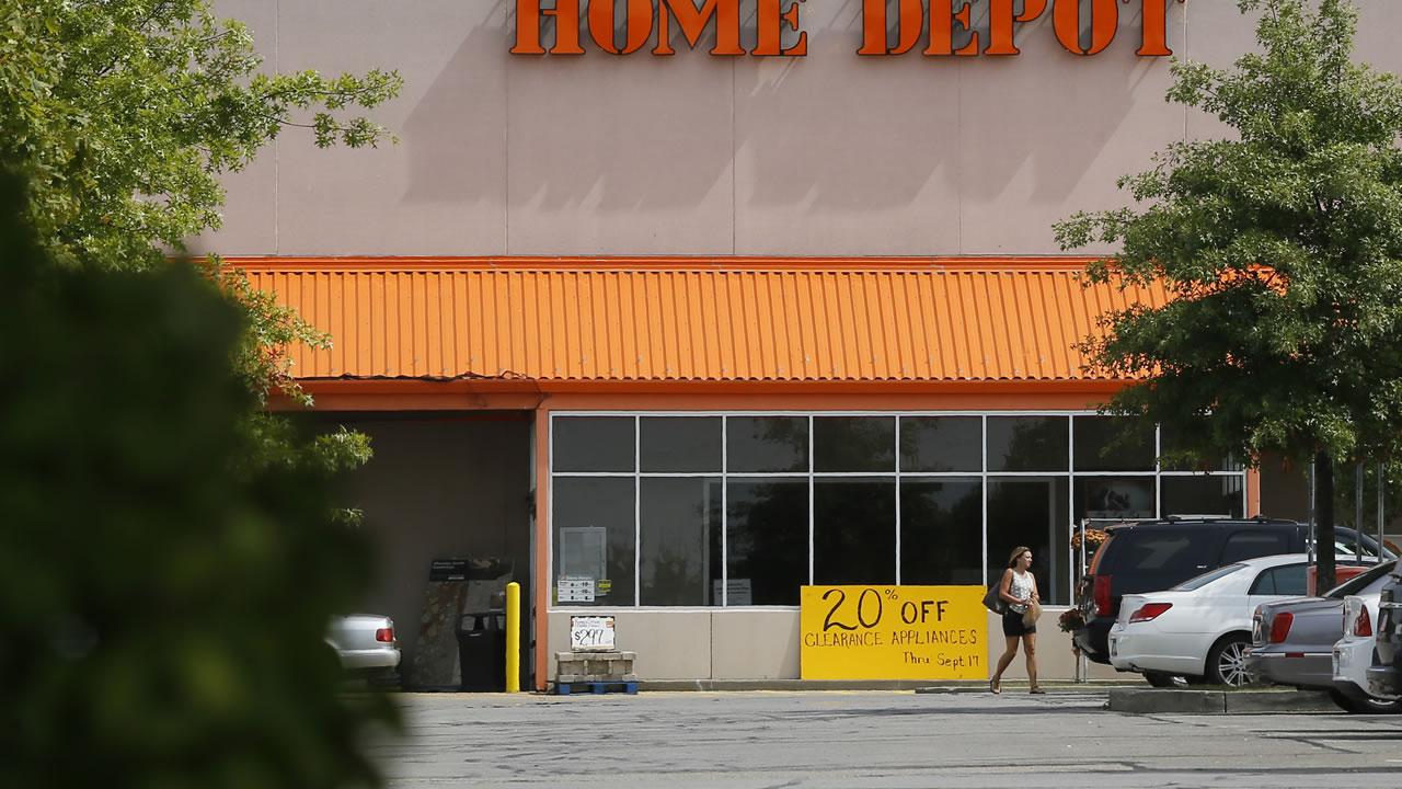 A customer walks out of a Home Depot.