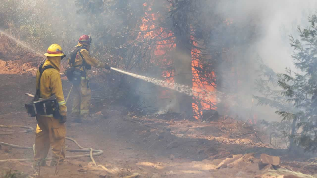 "<div class=""meta image-caption""><div class=""origin-logo origin-image ""><span></span></div><span class=""caption-text"">A firefighter hoses down flames from the King fire near Fresh Pond, Calif., Wednesday, Sept. 17, 2014. (AP Photo/Rich Pedroncelli)</span></div>"