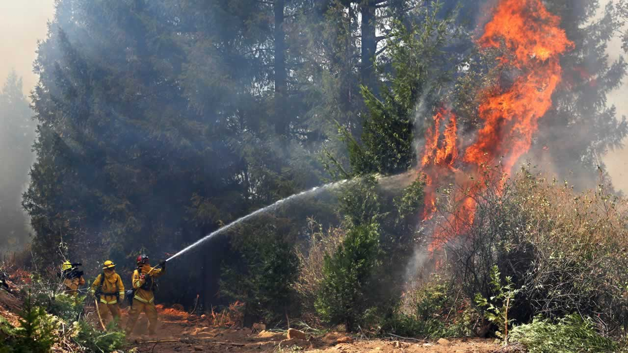 "<div class=""meta image-caption""><div class=""origin-logo origin-image ""><span></span></div><span class=""caption-text"">Firefighters battle the flames from the King fire near Fresh Pond, Calif., Wednesday, Sept. 17, 2014. (AP Photo/Rich Pedroncelli)</span></div>"