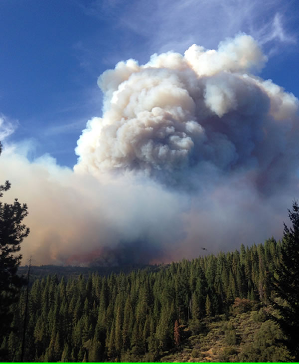 "<div class=""meta image-caption""><div class=""origin-logo origin-image ""><span></span></div><span class=""caption-text"">In this Tuesday, Sept. 16, 2014 photo, smoke and flames loom up over the King Fire in the Eldorado National Forest, seen from U.S. Highway 50 near the town of Pollock Pines, Calif. (AP Photo/Brendan Rice)</span></div>"