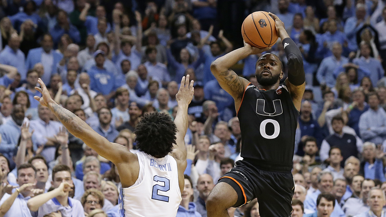 Miami's Ja'Quan Newton (0) shoots the game-winning shot as time expires while North Carolina's Joel Berry II (2) defends Tuesday in Chapel Hill.