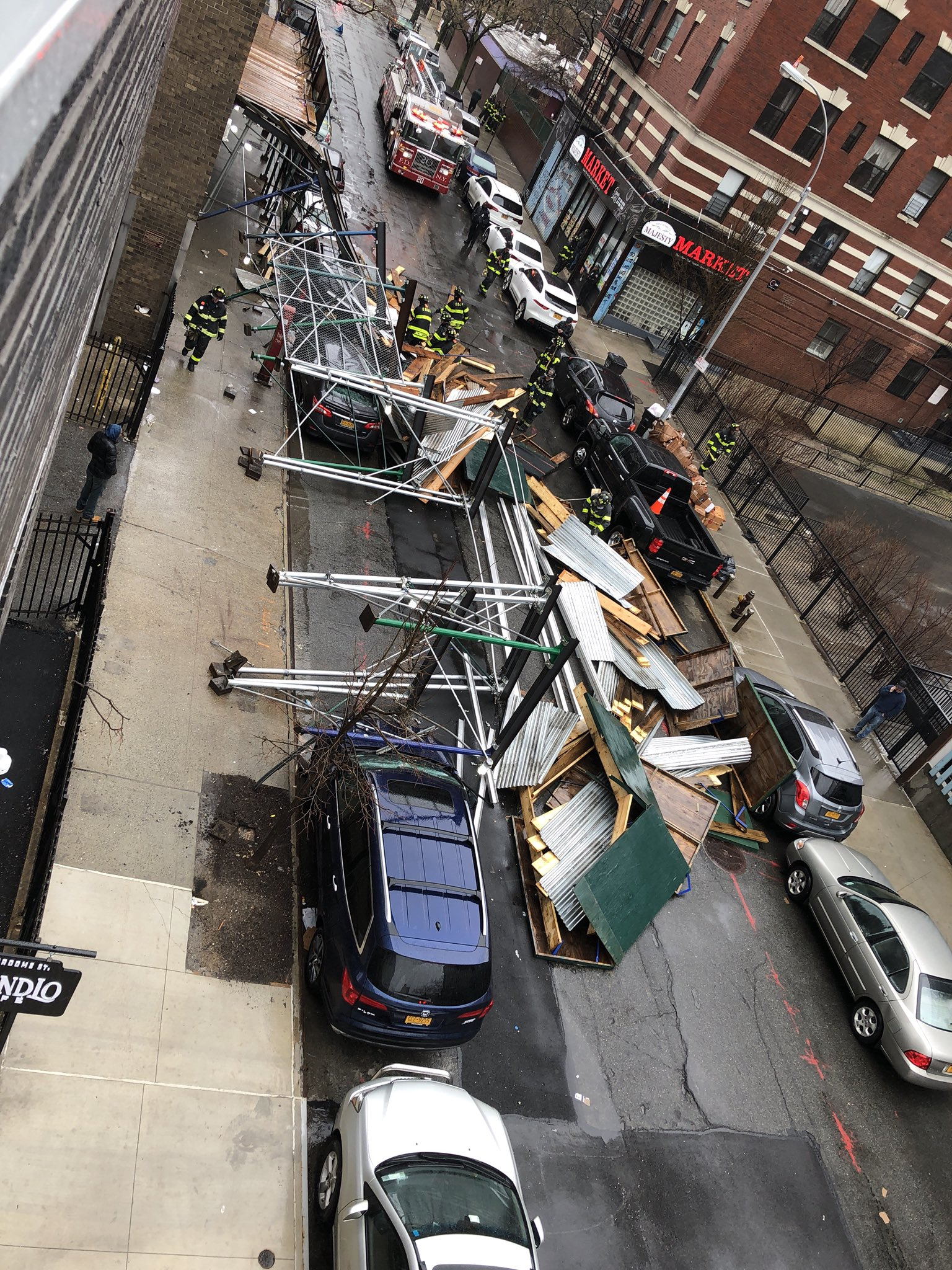 <div class='meta'><div class='origin-logo' data-origin='none'></div><span class='caption-text' data-credit='Twitter/@themanmoe'>Scaffolding collapse in the Lower East Side, Manhattan</span></div>