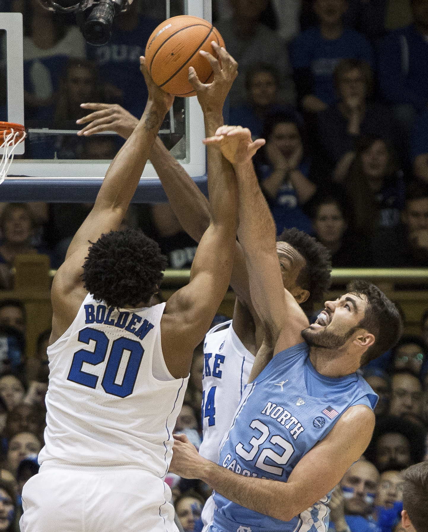 <div class='meta'><div class='origin-logo' data-origin='none'></div><span class='caption-text' data-credit='AP Photo/Ben McKeown'>North Carolina's Luke Maye (32) fights for a rebound with Duke's Marques Bolden (20) and Wendall Carter Jr. (34) during the first half of an NCAA college basketball game</span></div>