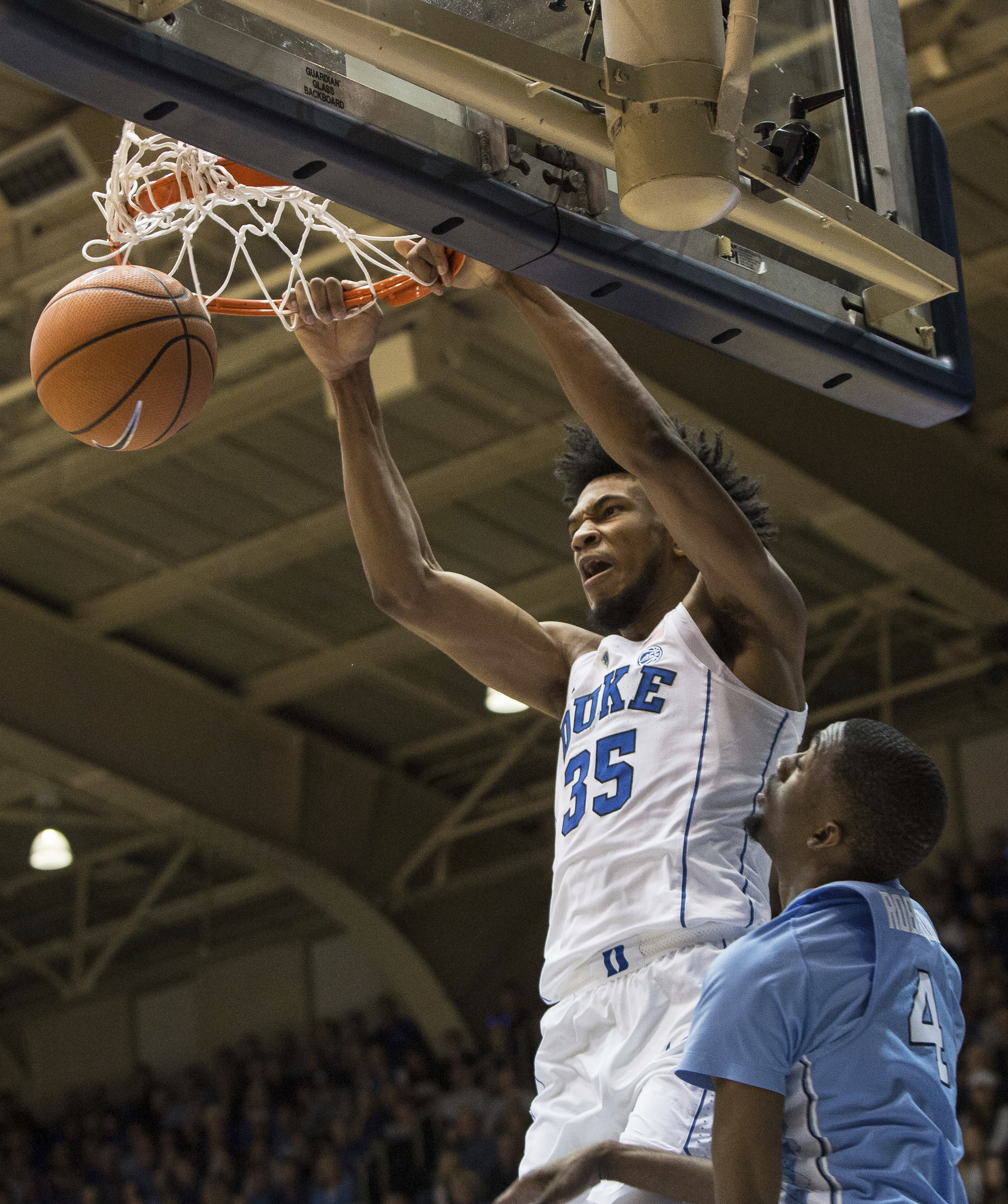 <div class='meta'><div class='origin-logo' data-origin='none'></div><span class='caption-text' data-credit='AP Photo/Ben McKeown'>Duke's Marvin Bagley III (35) dunks over North Carolina's Brandon Robinson (4) during the first half of an NCAA college basketball game</span></div>