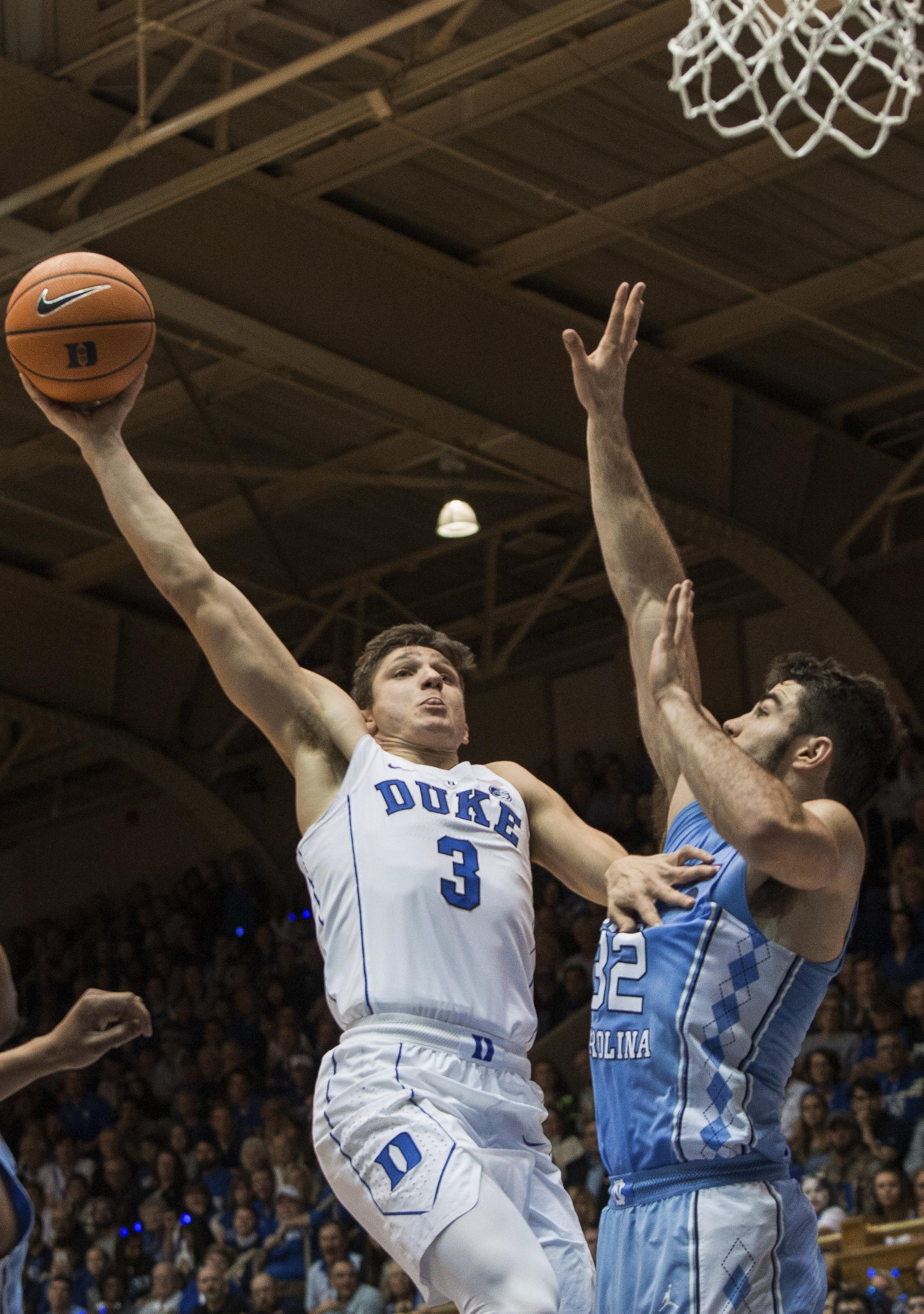 <div class='meta'><div class='origin-logo' data-origin='none'></div><span class='caption-text' data-credit='AP Photo/Ben McKeown'>Duke's Grayson Allen (3) jumps to attempt a dunk against North Carolina's Luke Maye (32) during the first half of an NCAA college basketball game</span></div>