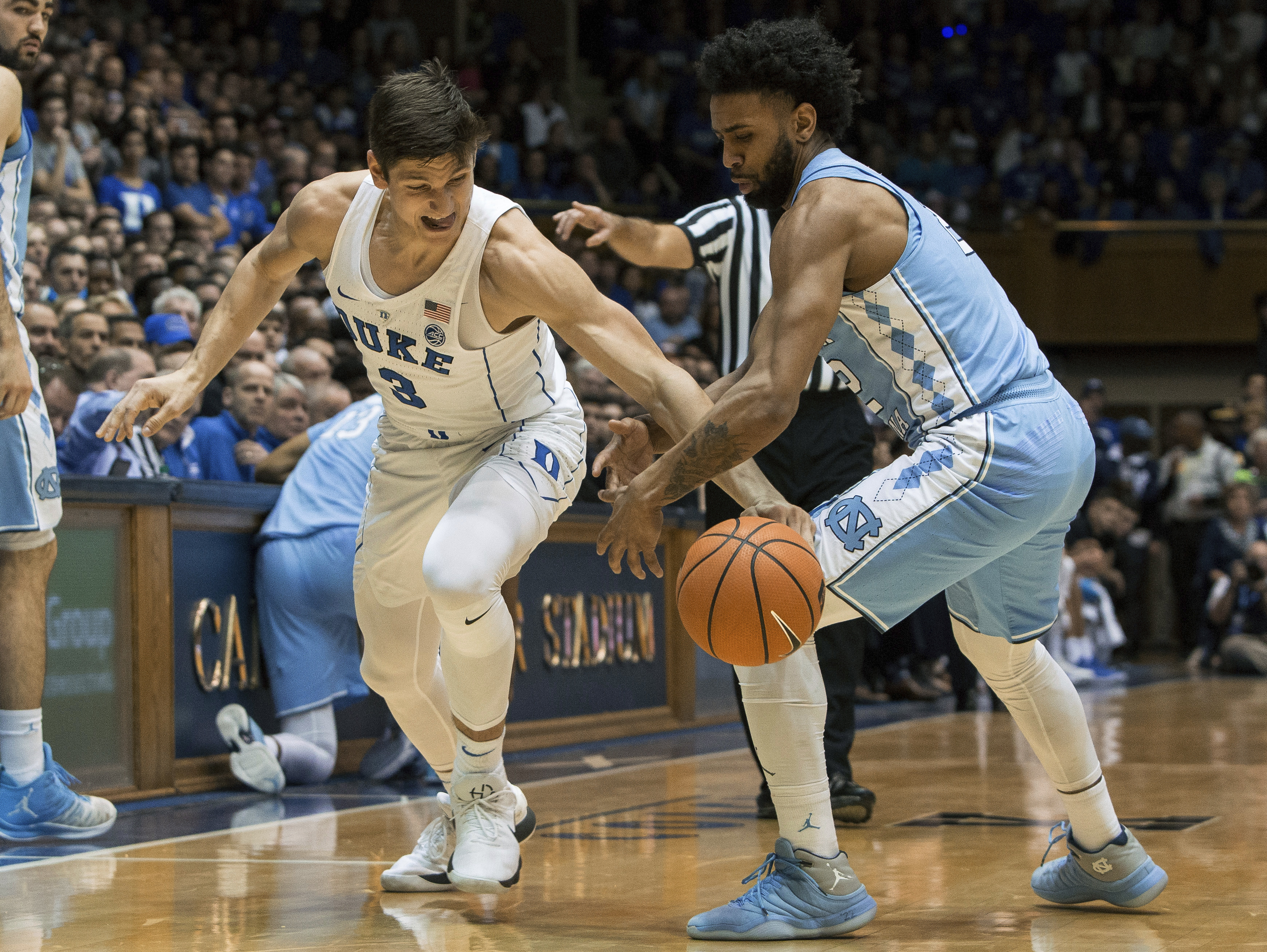 <div class='meta'><div class='origin-logo' data-origin='none'></div><span class='caption-text' data-credit='AP Photo/Ben McKeown'>Duke's Grayson Allen (3) and North Carolina's Joel Berry II fight for a loose ball during the first half of an NCAA college basketball game</span></div>
