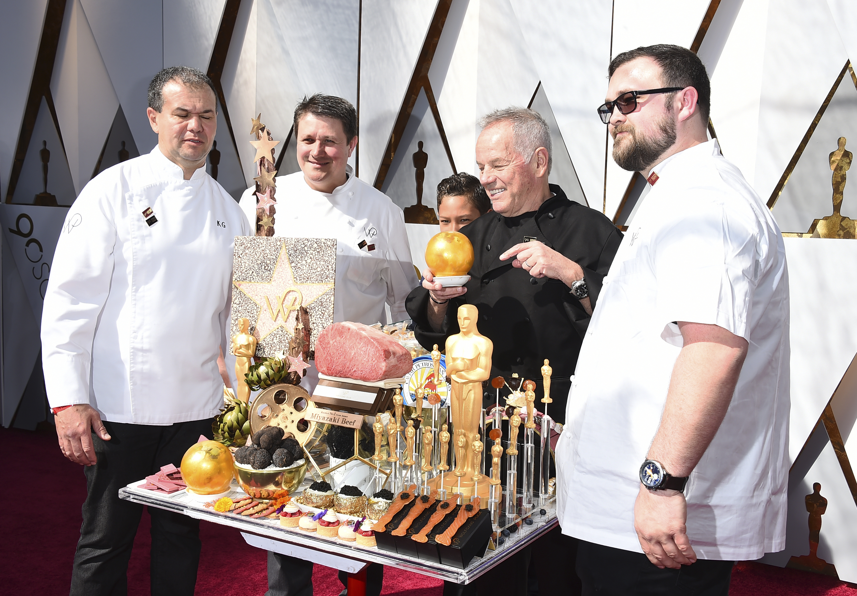 "<div class=""meta image-caption""><div class=""origin-logo origin-image none""><span>none</span></div><span class=""caption-text"">Wolfgang Puck, second from right, arrives at the Oscars on Sunday, March 4, 2018, at the Dolby Theatre in Los Angeles. (Jordan Strauss/Invision/AP)</span></div>"
