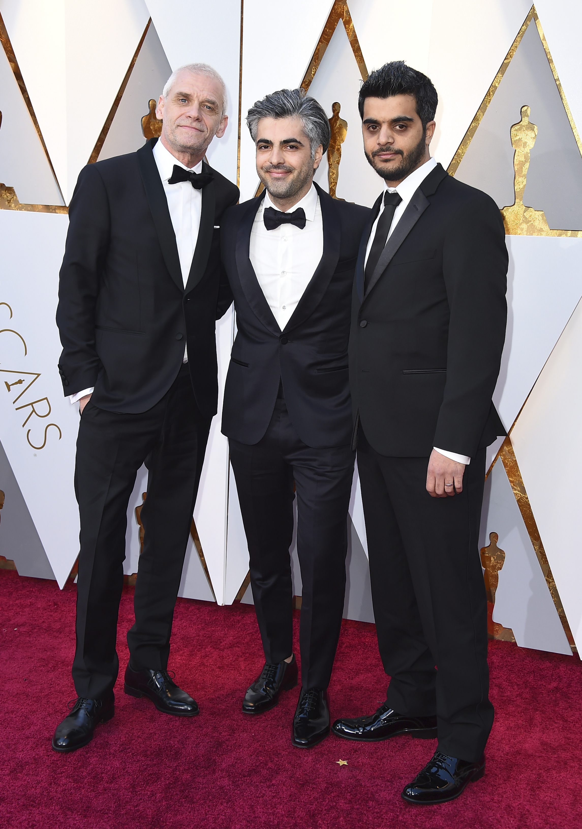 "<div class=""meta image-caption""><div class=""origin-logo origin-image none""><span>none</span></div><span class=""caption-text"">Soren Steen Jespersen, from left, Feras Fayyad, and Kareem Abeed, the team behind Best Documentary Feature nominee ''Last Men in Aleppo,'' arrive at the Oscars. (Jordan Strauss/Invision/AP)</span></div>"