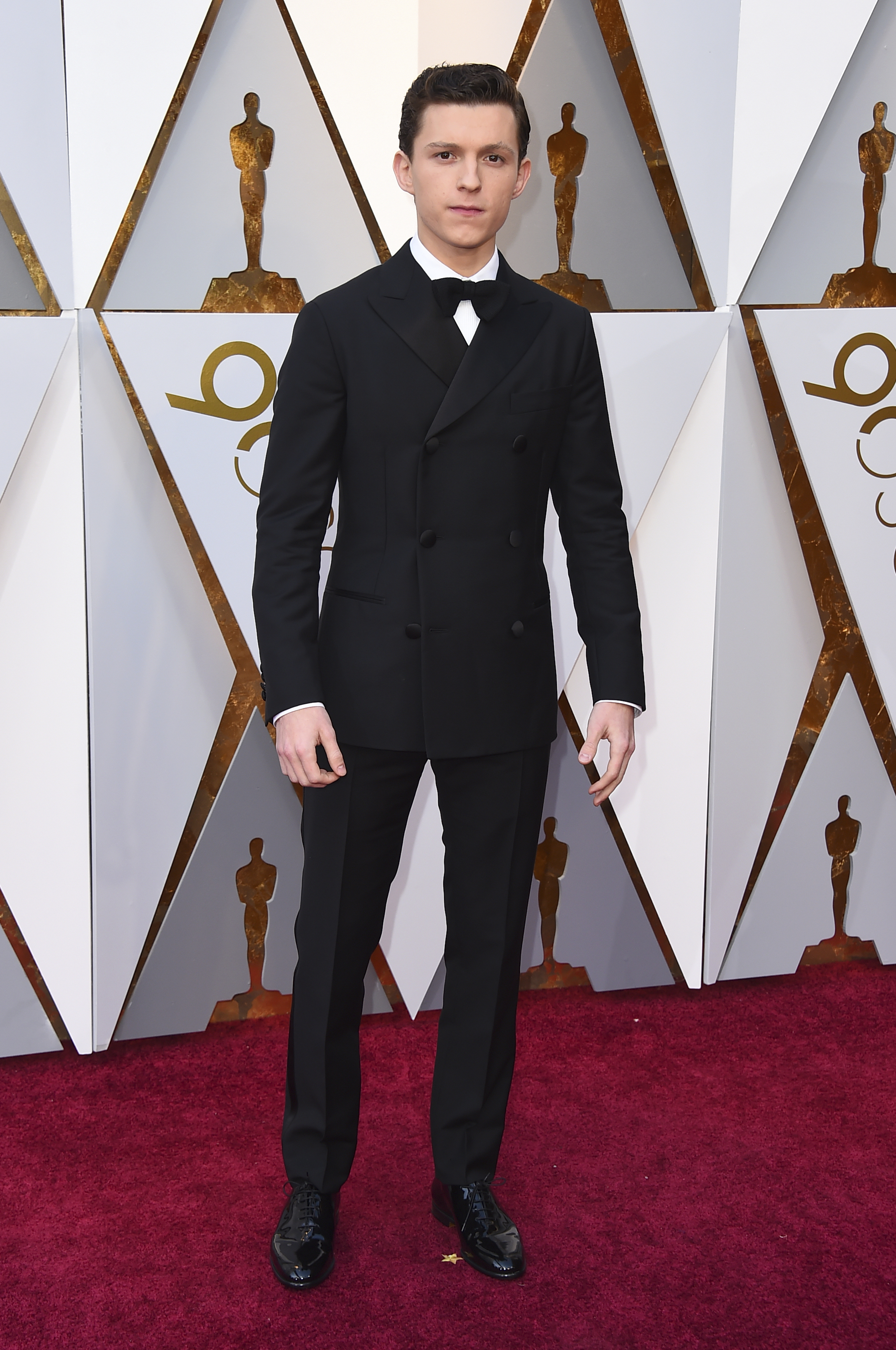 <div class='meta'><div class='origin-logo' data-origin='none'></div><span class='caption-text' data-credit='Jordan Strauss/Invision/AP'>Tom Holland of ''Spider-Man: Homecoming'' arrives at the Oscars on Sunday, March 4, 2018, at the Dolby Theatre in Los Angeles.</span></div>