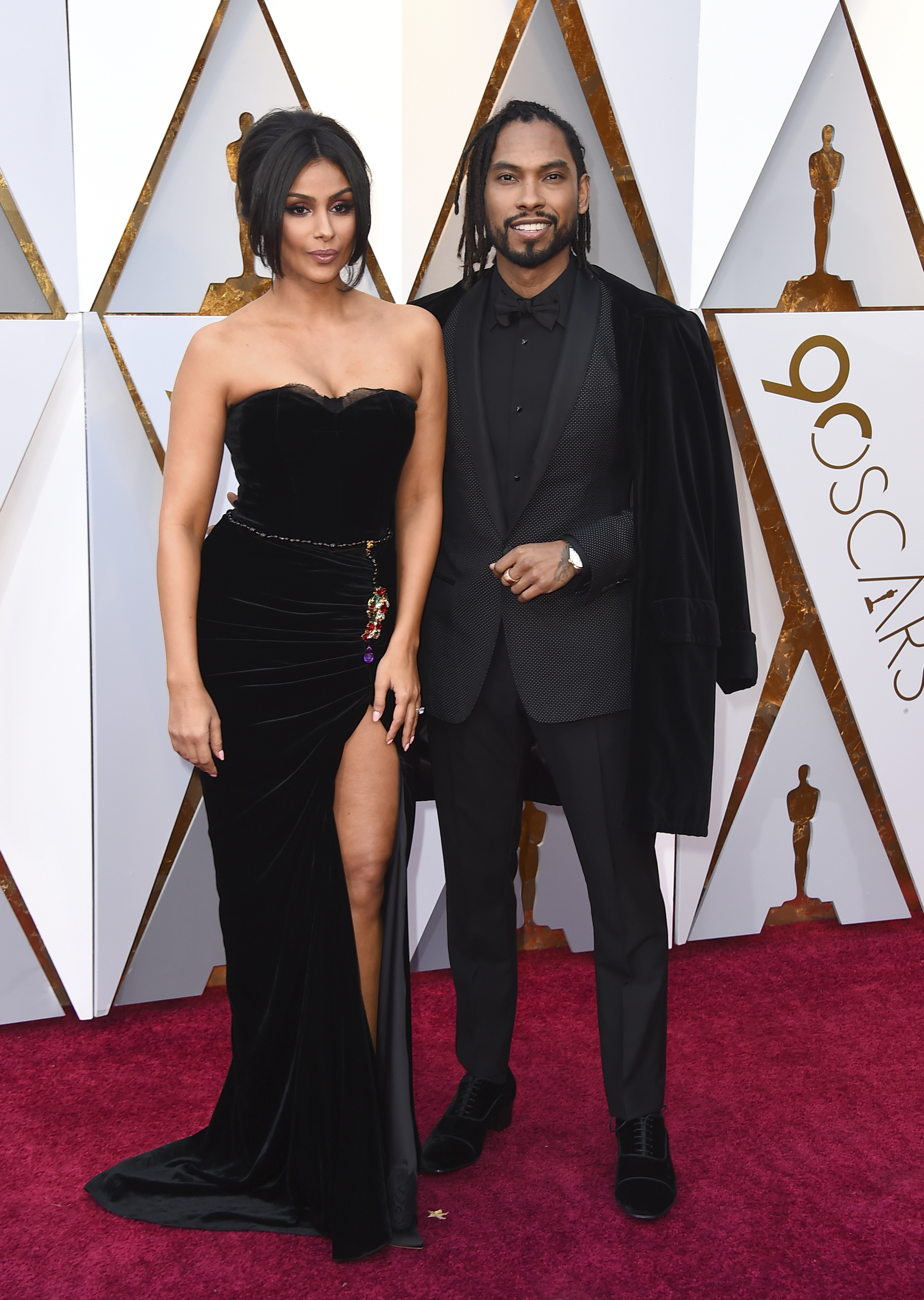 <div class='meta'><div class='origin-logo' data-origin='none'></div><span class='caption-text' data-credit='Jordan Strauss/Invision/AP'>Nazanin Mandi, left, and Miguel arrive at the Oscars on Sunday, March 4, 2018, at the Dolby Theatre in Los Angeles.</span></div>