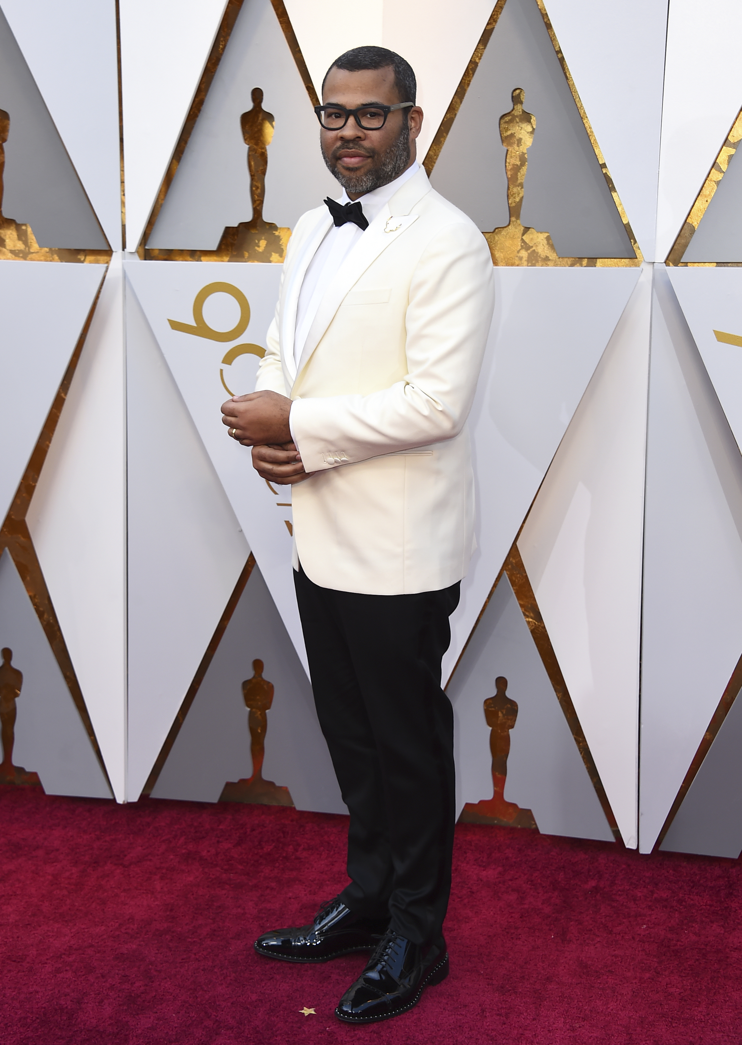 "<div class=""meta image-caption""><div class=""origin-logo origin-image none""><span>none</span></div><span class=""caption-text"">Jordan Peele, nominated both for writing and directing ''Get Out,'' arrives at the Oscars on Sunday, March 4, 2018, at the Dolby Theatre in Los Angeles. (Jordan Strauss/Invision/AP)</span></div>"