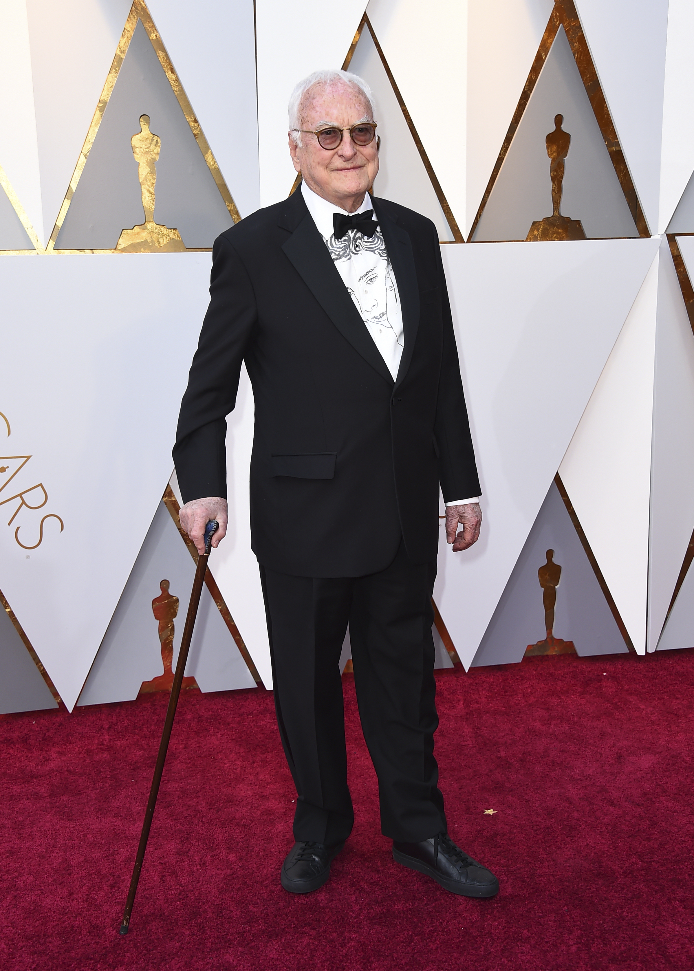 <div class='meta'><div class='origin-logo' data-origin='none'></div><span class='caption-text' data-credit='Jordan Strauss/Invision/AP'>James Ivory arrives at the Oscars on Sunday, March 4, 2018, at the Dolby Theatre in Los Angeles.</span></div>