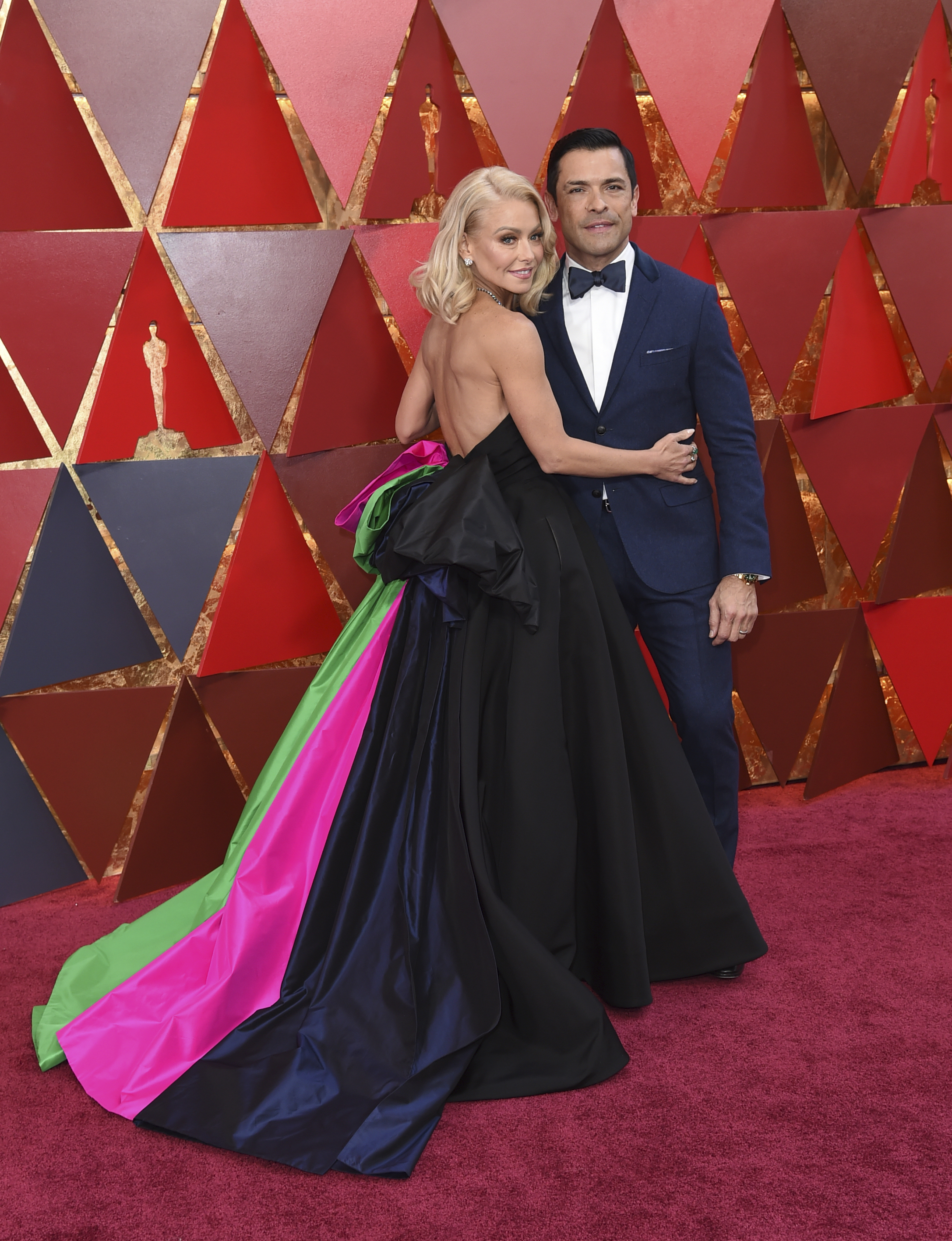 "<div class=""meta image-caption""><div class=""origin-logo origin-image none""><span>none</span></div><span class=""caption-text"">Kelly Ripa, left, and Mark Consuelos arrive at the Oscars on Sunday, March 4, 2018, at the Dolby Theatre in Los Angeles. (Richard Shotwell/Invision/AP)</span></div>"