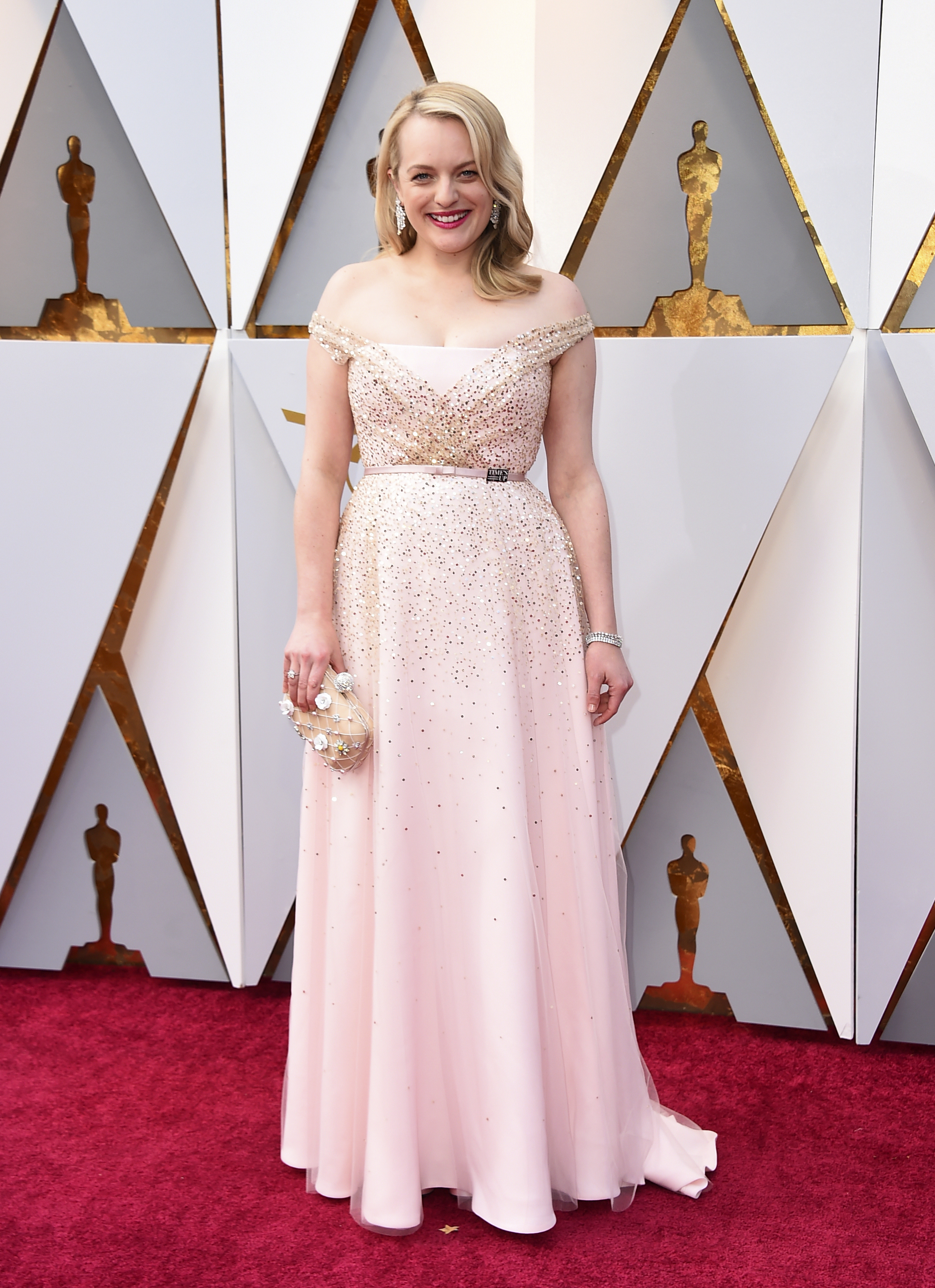 <div class='meta'><div class='origin-logo' data-origin='none'></div><span class='caption-text' data-credit='Jordan Strauss/Invision/AP'>Elisabeth Moss arrives at the Oscars on Sunday, March 4, 2018, at the Dolby Theatre in Los Angeles.</span></div>