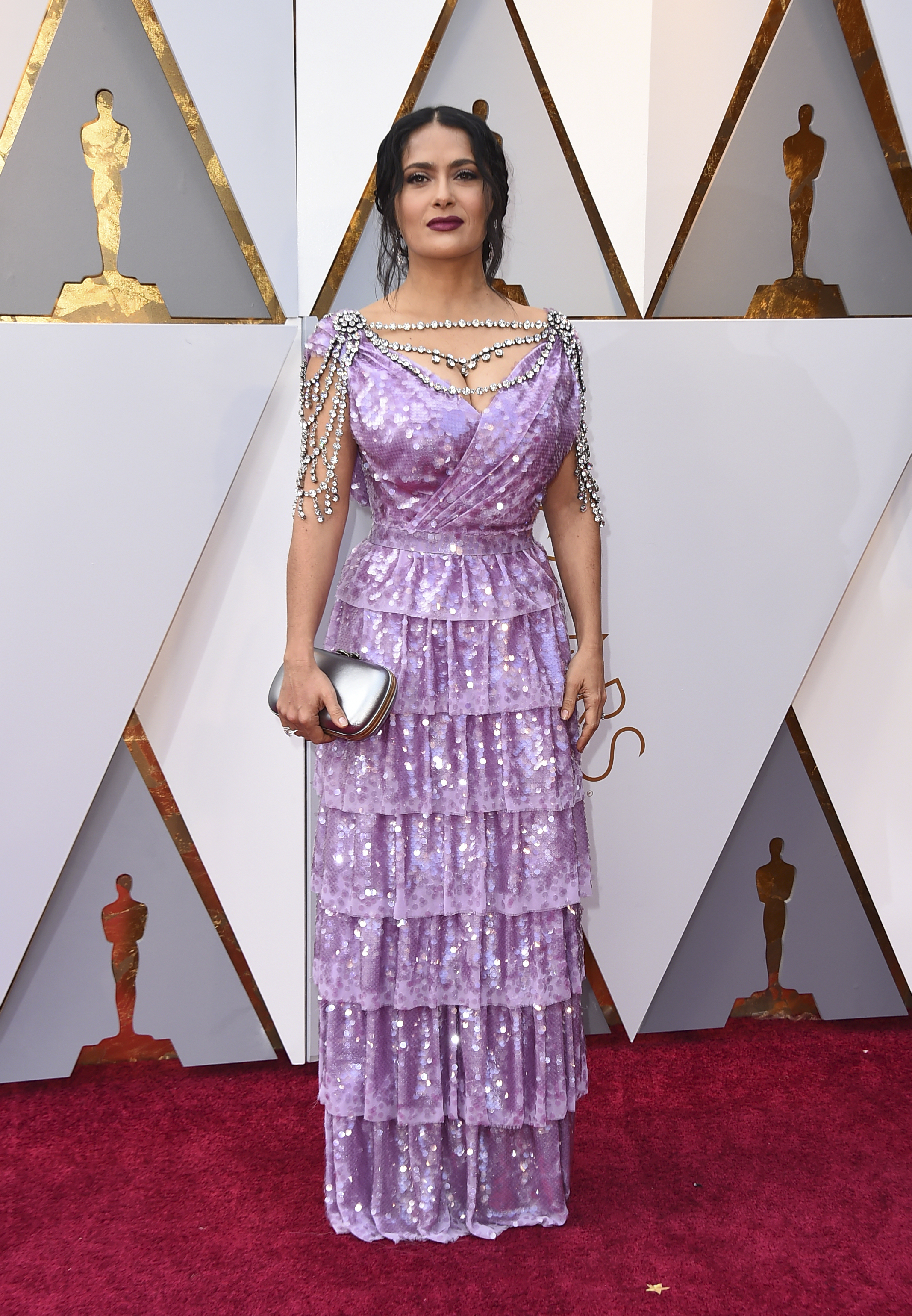 <div class='meta'><div class='origin-logo' data-origin='none'></div><span class='caption-text' data-credit='Jordan Strauss/Invision/AP'>Salma Hayek arrives at the Oscars on Sunday, March 4, 2018, at the Dolby Theatre in Los Angeles.</span></div>