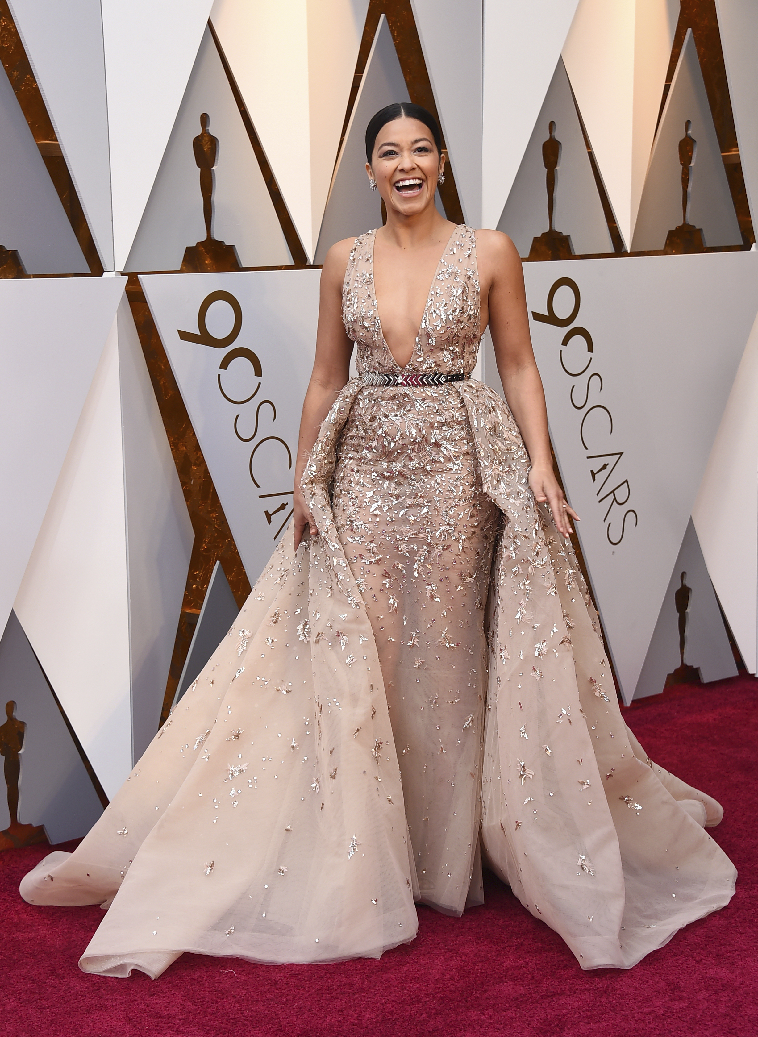 <div class='meta'><div class='origin-logo' data-origin='none'></div><span class='caption-text' data-credit='Jordan Strauss/Invision/AP'>Gina Rodriguez arrives at the Oscars on Sunday, March 4, 2018, at the Dolby Theatre in Los Angeles.</span></div>