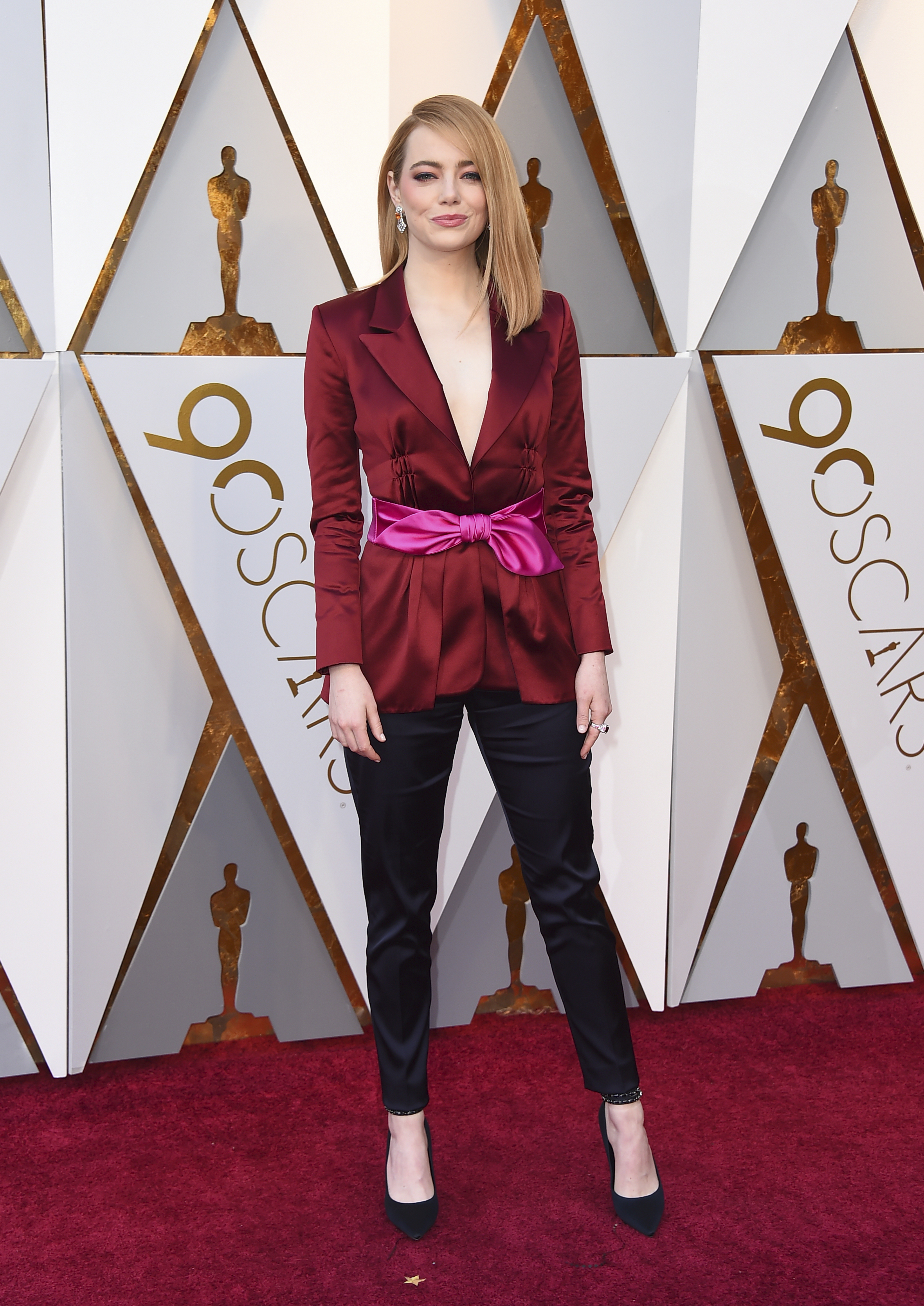 <div class='meta'><div class='origin-logo' data-origin='none'></div><span class='caption-text' data-credit='Jordan Strauss/Invision/AP'>Last year's Best Actress winner Emma Stone arrives at the Oscars on Sunday, March 4, 2018, at the Dolby Theatre in Los Angeles.</span></div>