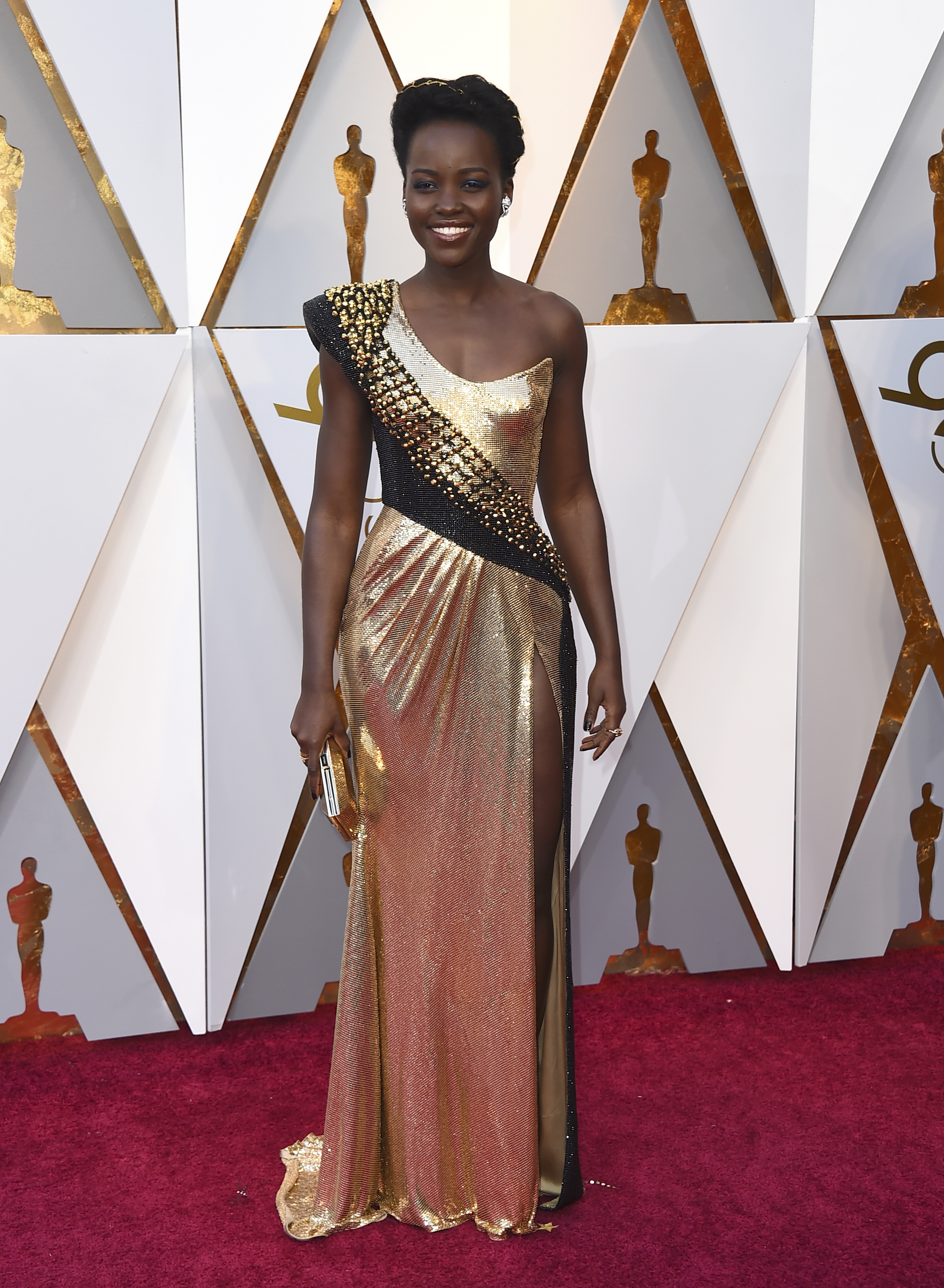 <div class='meta'><div class='origin-logo' data-origin='none'></div><span class='caption-text' data-credit='Jordan Strauss/Invision/AP'>Previous Oscar winner Lupita Nyong'o arrives at the Oscars on Sunday, March 4, 2018, at the Dolby Theatre in Los Angeles.</span></div>