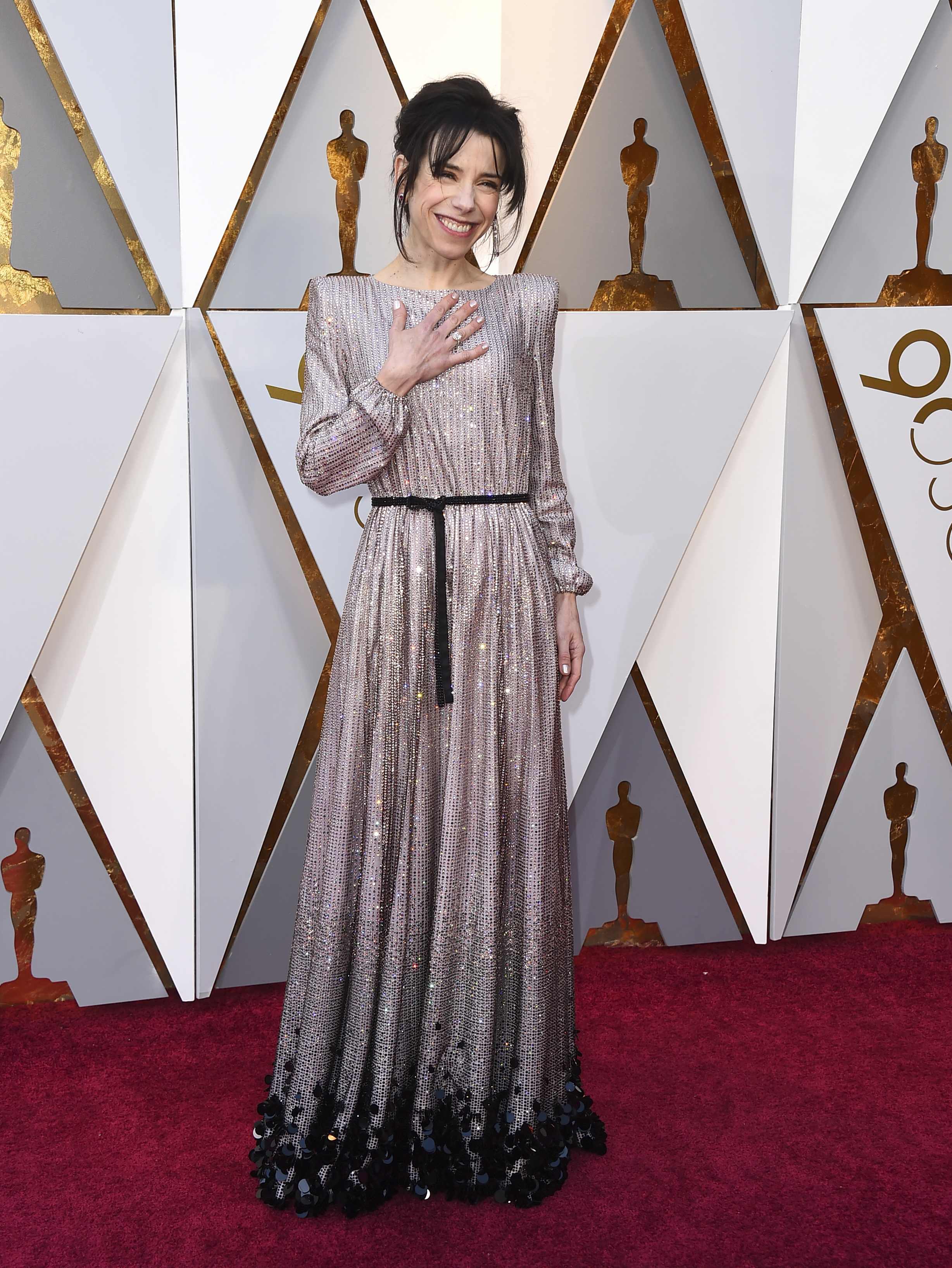 "<div class=""meta image-caption""><div class=""origin-logo origin-image none""><span>none</span></div><span class=""caption-text"">Sally Hawkins, nominated for Best Actress for ''The Shape of Water,'' arrives at the Oscars on Sunday, March 4, 2018, at the Dolby Theatre in Los Angeles. (Jordan Strauss/Invision/AP)</span></div>"