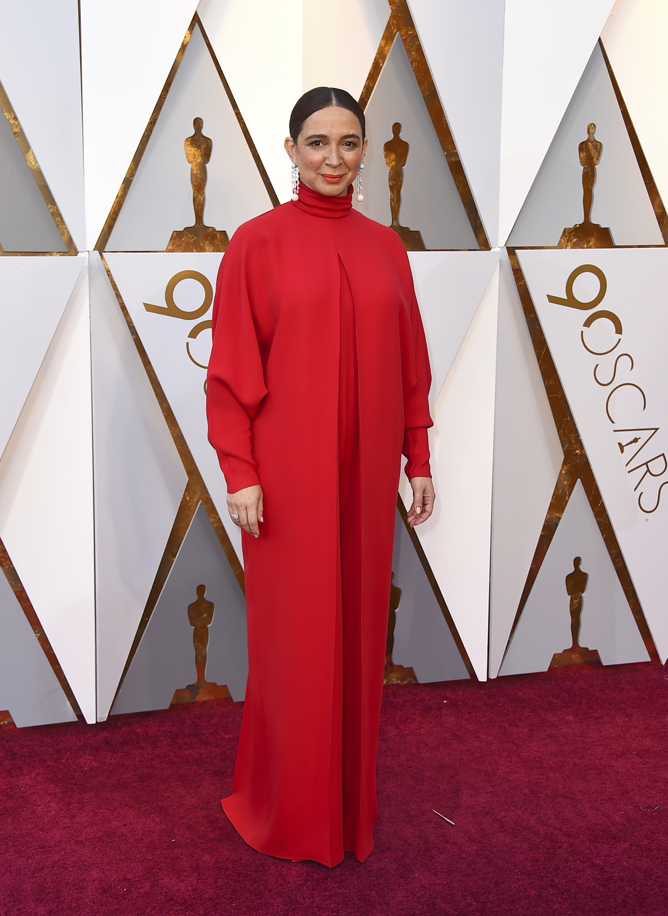 <div class='meta'><div class='origin-logo' data-origin='none'></div><span class='caption-text' data-credit='Jordan Strauss/Invision/AP'>Maya Rudolph arrives at the Oscars on Sunday, March 4, 2018, at the Dolby Theatre in Los Angeles.</span></div>