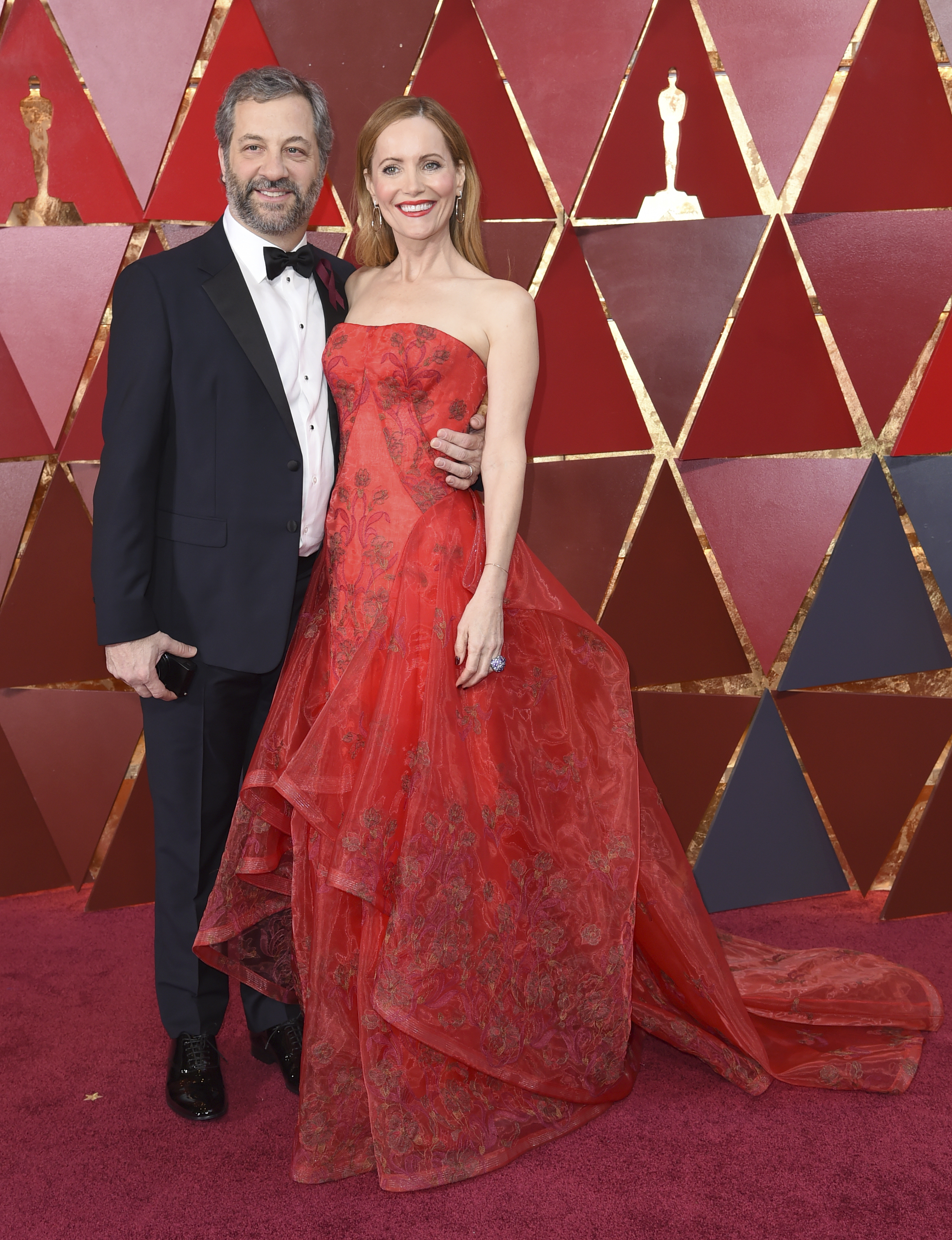 "<div class=""meta image-caption""><div class=""origin-logo origin-image none""><span>none</span></div><span class=""caption-text"">Judd Apatow, left, and Leslie Mann arrive at the Oscars on Sunday, March 4, 2018, at the Dolby Theatre in Los Angeles. (Richard Shotwell/Invision/AP)</span></div>"